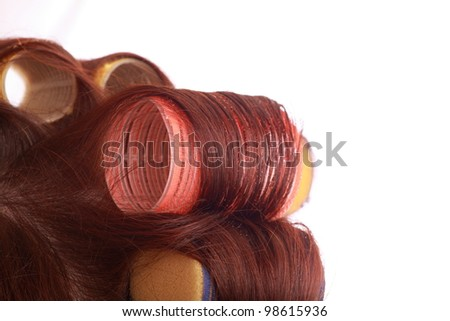 close-up of curlers in hair isolated on white - stock photo