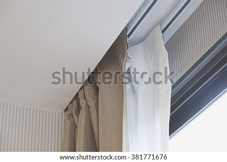 Close up of curtain. part of draperies at a window. - stock photo