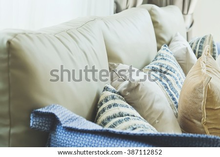 Close up of cushion on sofa in living room - stock photo