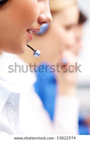 Close-up of customer support representative speaking into mic during work - stock photo