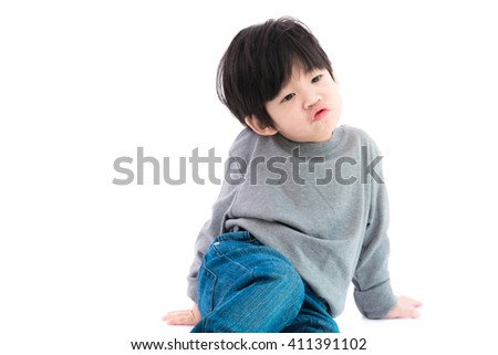 Close up of cute asian boy on white background isolated.