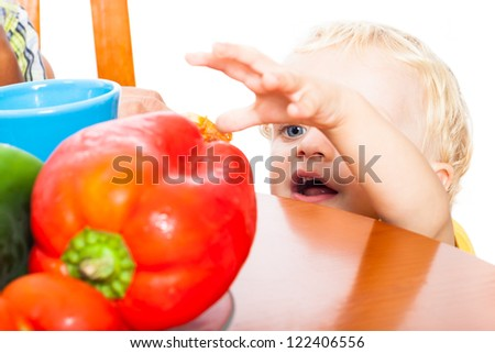 Close up of cute child boy and healthy food, isolated on white background. - stock photo