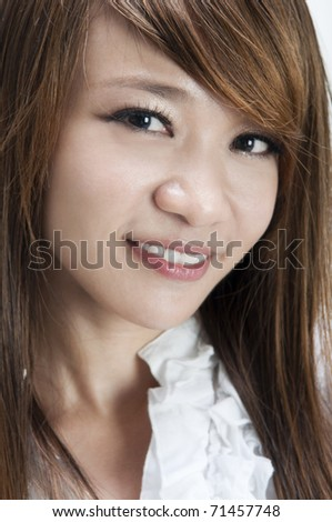 Close up of cute young Asian female smiling - stock photo