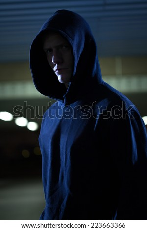 Close-up of dangerous man at the night - stock photo