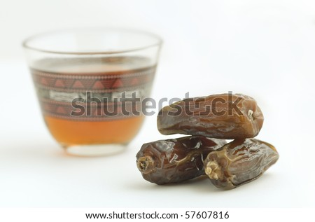Close up of dates and a traditional arabic tea cup. - stock photo