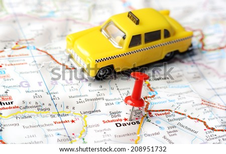 Close up of Davos,  Swiss  map with red pin and a taxi   - Travel concept - stock photo