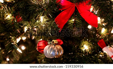 Close up of decorated Christmas tree with ornaments and lights.  - stock photo