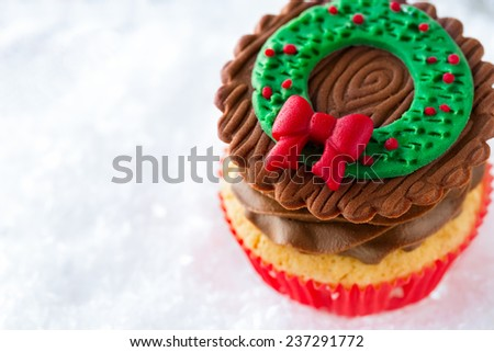 Close-up of decorative Christmas cupcake with traditional decorative symbol on top - stock photo