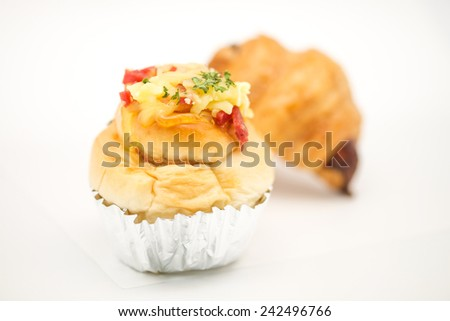 Close up of delicious and fresh baked pastries for refreshment on white background  - stock photo