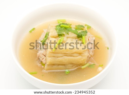 Close up of delicious Chinese / Thai bitter gourd with grounded pork soup for cuisine on white background - stock photo