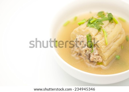 Close up of delicious Chinese / Thai bitter gourd with grounded pork soup for food on white background - stock photo