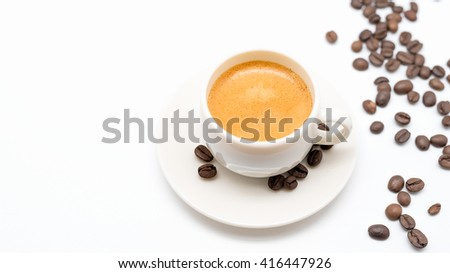 Close-up of delicious espresso in white cup on isolated background - stock photo
