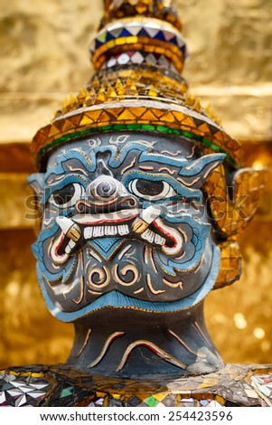 Close-up of demon guardian statue at the temple Wat phra kaew in the Grand palace, Bangkok, Thailand. - stock photo