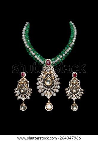 Close up of diamond and pearl necklace on black background with earrings - stock photo