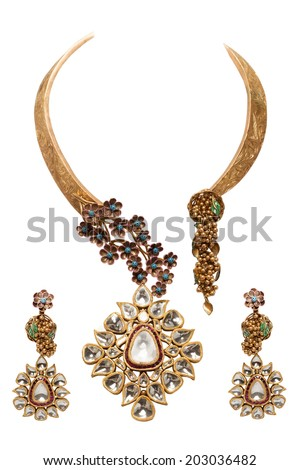 Close up of diamond necklace and earrings white background
