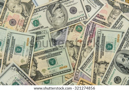 Close up of different dollar bills - stock photo