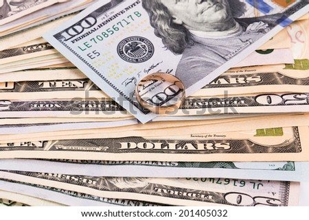 Close up of different dollar bills with golden ring. Whole background.