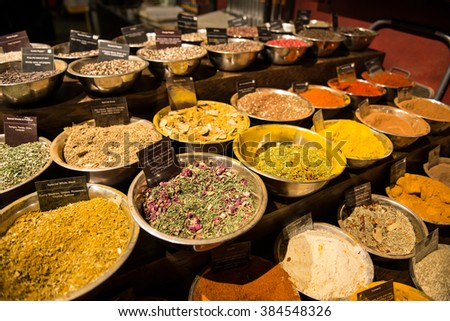 Close-up of different types of Assorted Spices in metal plates in the market store