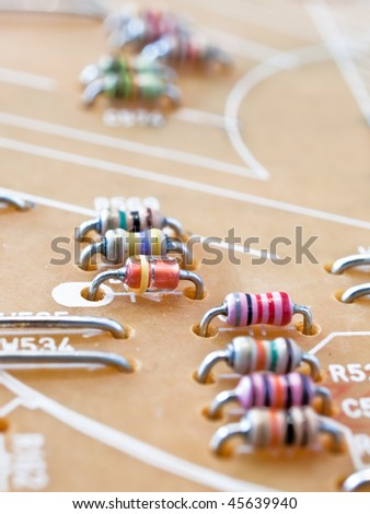 Close up of differently colored resistors on a circuit board, into the distance - stock photo