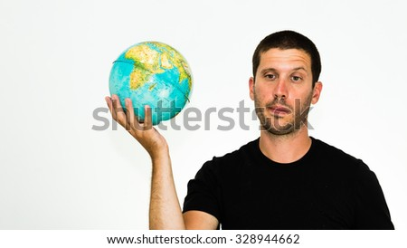 close-up of disheartened caucasian man holding a world globe in his hand - conceptual image isolated on white background with copyspace