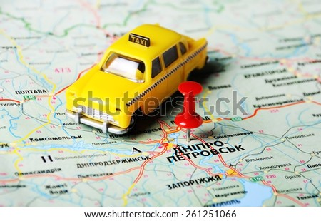 Close up of  Dnepropetrovsk  ,Ukraine , map with red pin and a taxi toy - stock photo