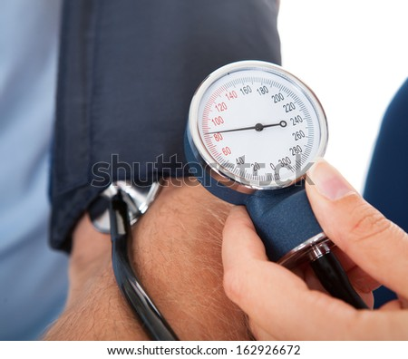 Close-up of Doctor Checking Blood Pressure Of A Patient - stock photo