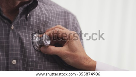 Close-up of doctor checking patient's vitals  - stock photo
