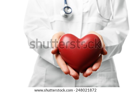 Close-up of doctor hands with heart - stock photo