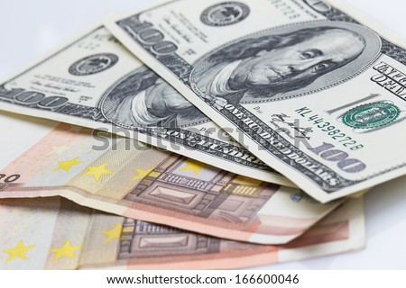 Close up of dollars and euros - stock photo