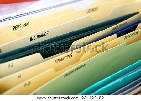 Close up of domestic personal files in expanding pocket folders - stock photo