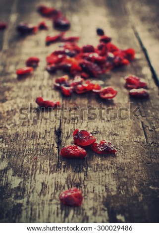 Close up of Dried Cranberries on Wooden Table. Healthy food organic nutrition. Toned - stock photo