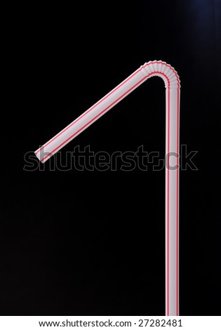 close up of drinking straw on black background - stock photo