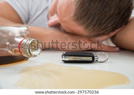 Close-up Of Drunk Man With Glass Of Liquor And Car Key - stock photo