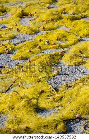 Close-up of drying yellow fishers nets with their floaters in the mediterranean sun .Fish is such an important part of the Greek diet. - stock photo