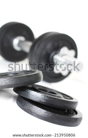 Close up of dumbbell weights isolated over white background. Fitness bodybuilding concept. - stock photo