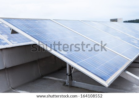 Close-up Of Eco Friendly Solar Panels On Roof - stock photo