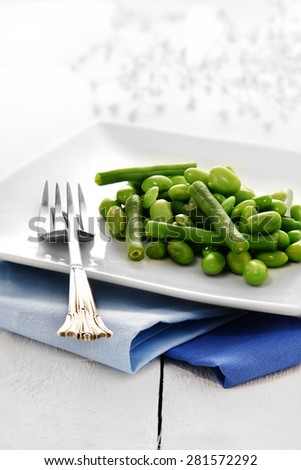 Close-up of Edamame bean salad against a bright, light background. Concept image for healthy eating. Copy space. - stock photo