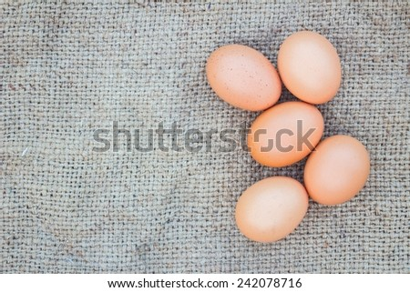 Close up of eggs on gunnysack for cook, with copyspace - stock photo