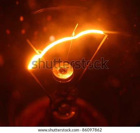Close up of electric  tungsten bulb illuminating - stock photo