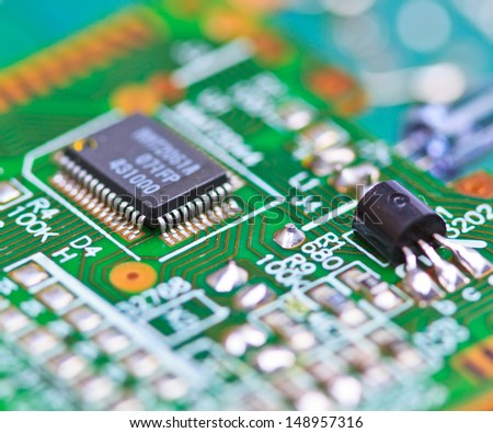 Close-up of electronic circuit board macro and remote - stock photo