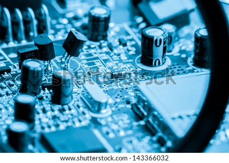 close-up of electronic circuit board on blue background