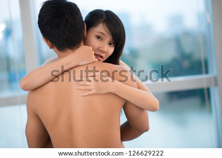 Close up of embracing naked young couple - stock photo