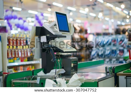 Close up of empty cash desk with computer terminal in supermarket - stock photo