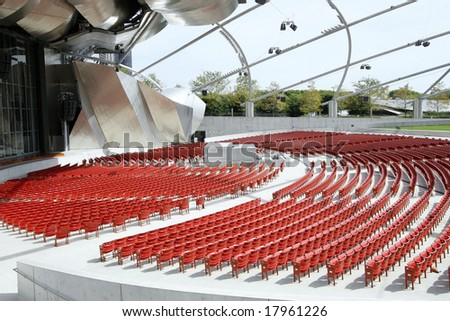 Close-up of empty red chairs - stock photo