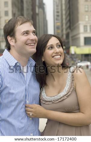 Close-up of engaged couple smiling - stock photo
