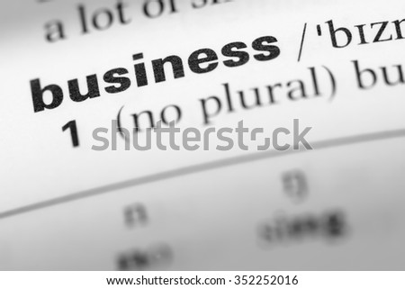 Close up of English dictionary page with word business