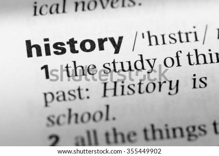 Close up of English dictionary page with word history - stock photo