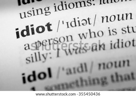 Close up of English dictionary page with word idiot