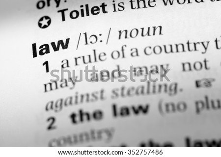 Close up of English dictionary page with word law - stock photo