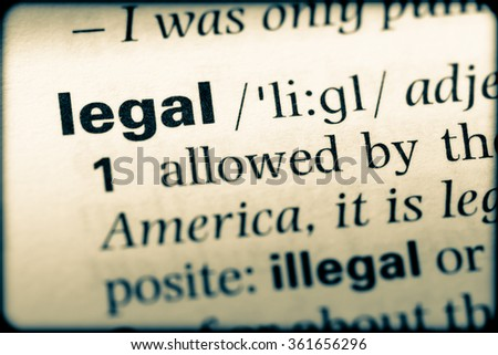 Close up of English dictionary page with word legal - stock photo